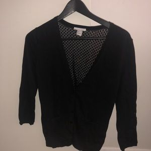 Button up cardigan with see through back.
